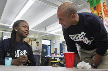 Governor Deval Patrick and Adejoke Atitebi, 13, of Revere, participated in Project 351, a day of service.